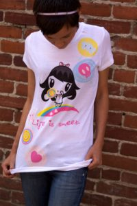 Woman wearing the Lolligag Life Is Sweet/Suck It T-shirt
