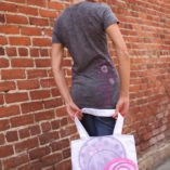 Girl holding the Lolligag 2-Cute Tote Bag