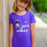 Girl wearing a shirt featuring Lolligag and Moot floating in space