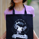 Woman wearing Lolligag Tote around her neck