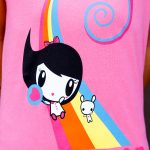 T-shirt artwork of Lolligag and Moot sliding down a rainbow