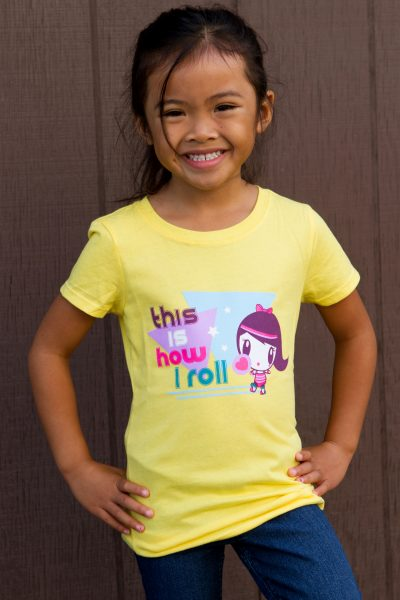 Girl wearing This Is How I Roll Lolligag Kids Tee