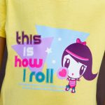 Girl wearing a shirt featuring artwork of Lolligag on roller skates