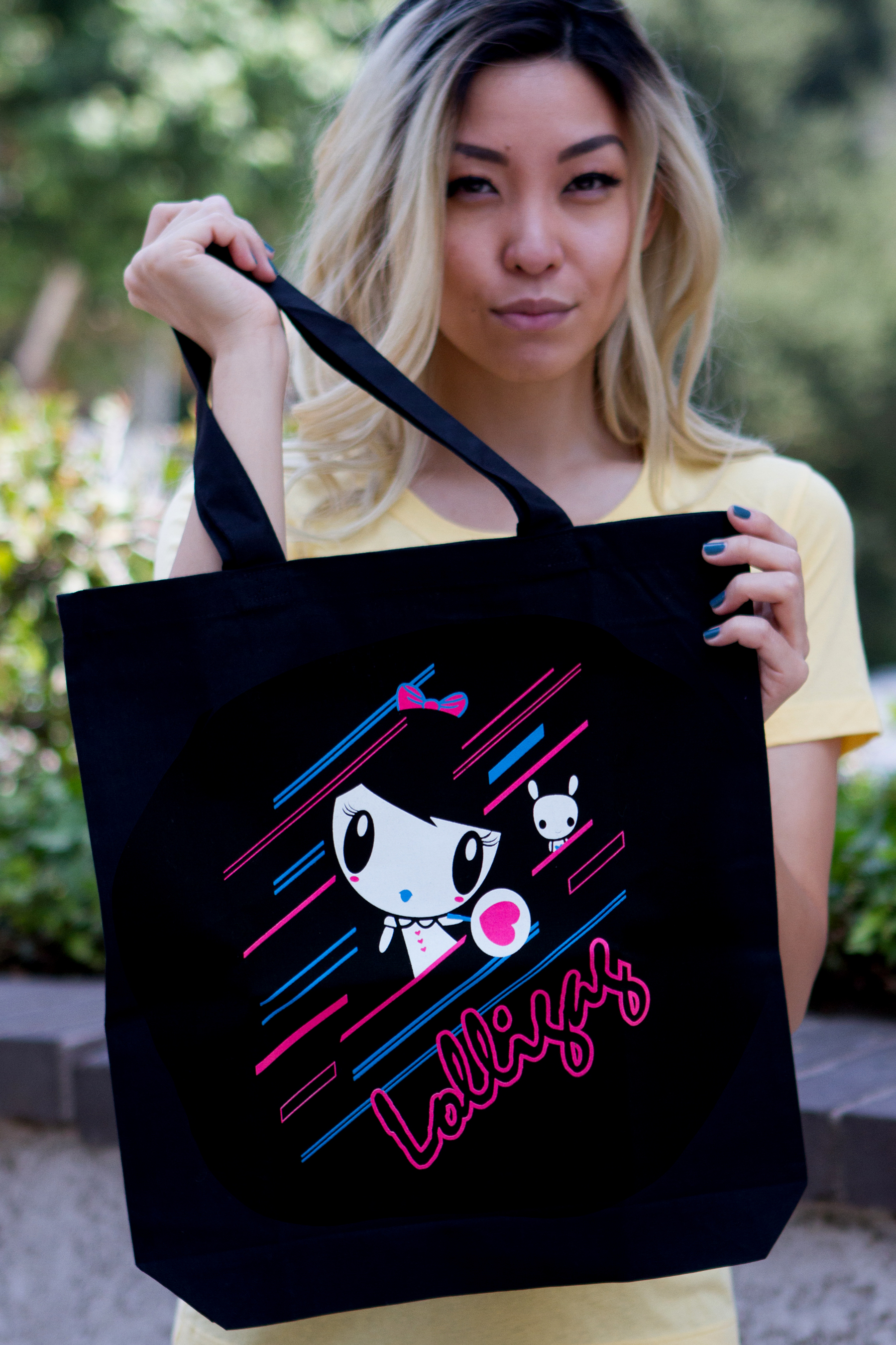 Woman holding the Electric Lolligag & Moot Tote