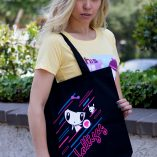 Woman holding the Electric Lolligag and Moot Tote