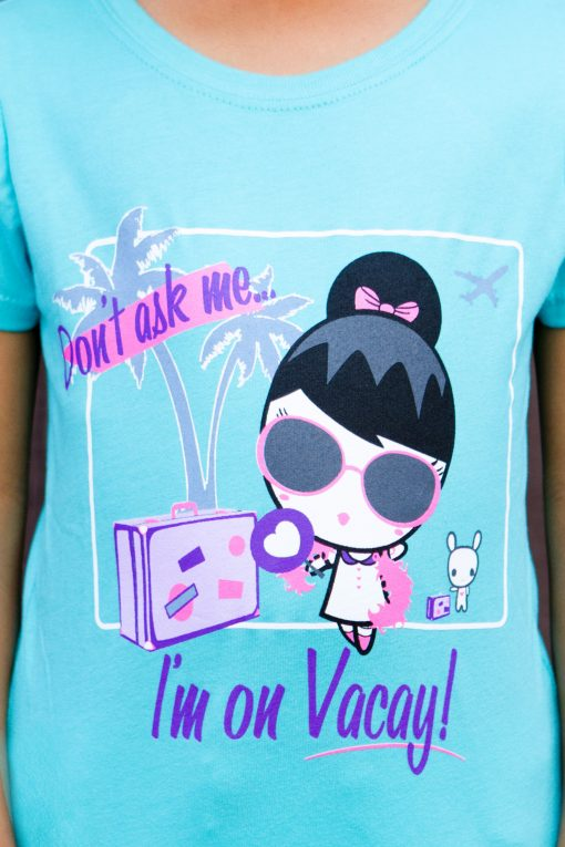 T-shirt with artwork featuring Lolligag and Moot with luggage, a palm tree and a plane