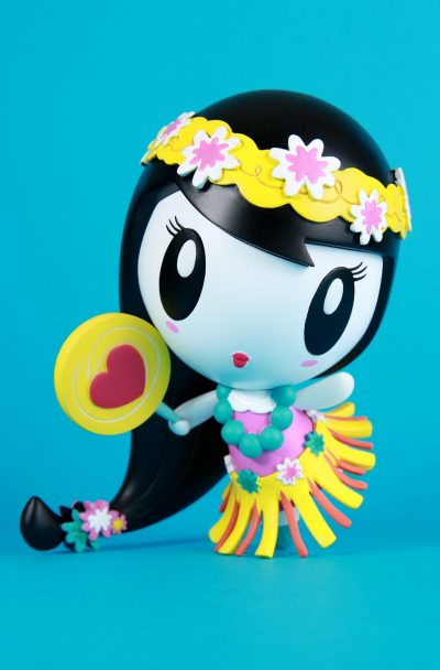 Art toy with Lolligag dressed as a hula girl in yellow and pink