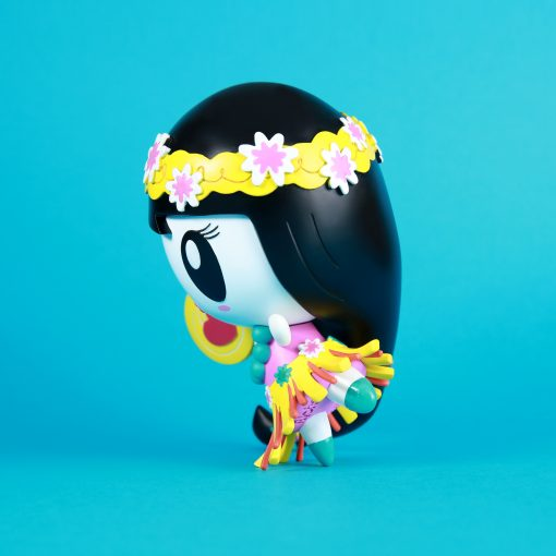 A vinyl art toy of Lolligag dressed as a hula girl