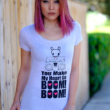 Woman wearing a t-shirt with Moot on top of a boombox with words You Make My Heart Go Boom Boom