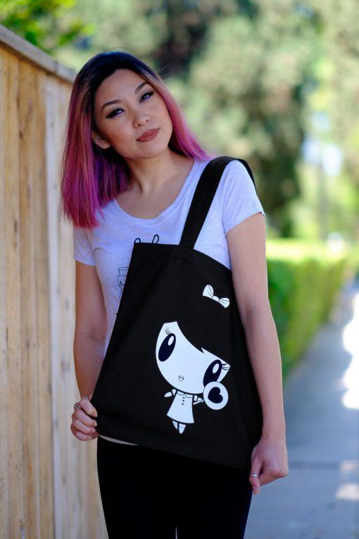Girl holding Noir Lolligag Tote