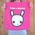Model holding Totes Adorbs Moot Tote Bag