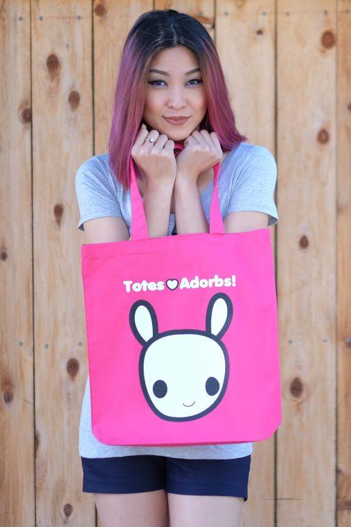 Girl holding Totes Adorbs Moot Tote Bag