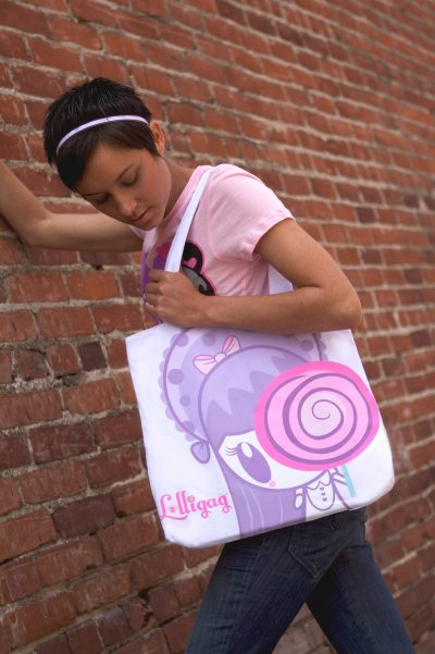 Woman holding 2-Cute Tote Bag - Side 1