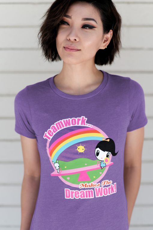 A woman wears the Teamwork Makes the Dream Work Lolligag T-shirt