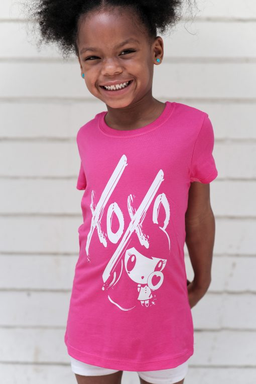 Girl wearing a Lolligag XOXO Kids T-shirt