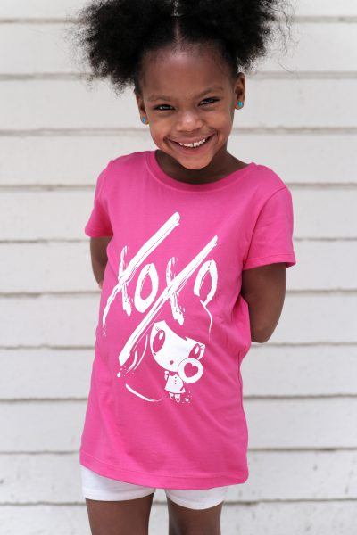 Girl wearing Lolligag XOXO Kids Tee