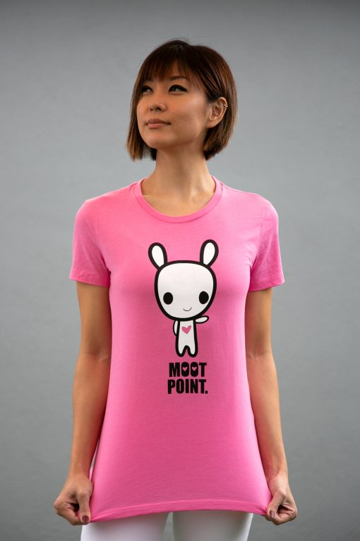 A women wearing a shirt featuring character art of the character Moot pointing