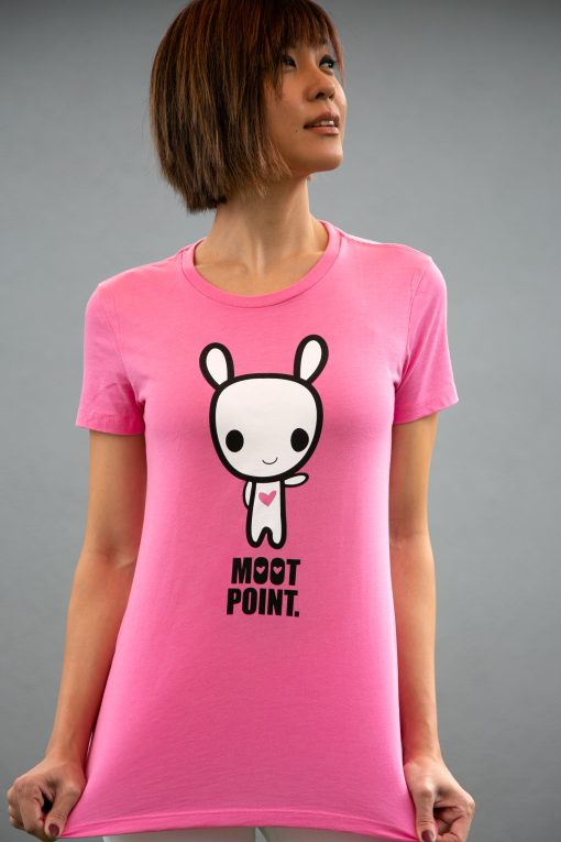 A girl wearing a shirt featuring character art of the character Moot pointing